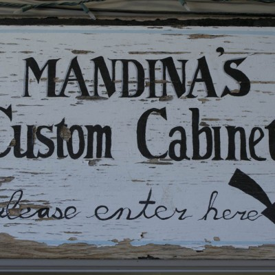 Old Mandina's Custom Cabinets sign